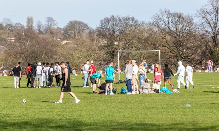 Large crowds have been seen gathering in beauty spots in England since outdoor social distancing rules were relaxed on Monday. Pictured: Abingto Park, Northampton, March 30