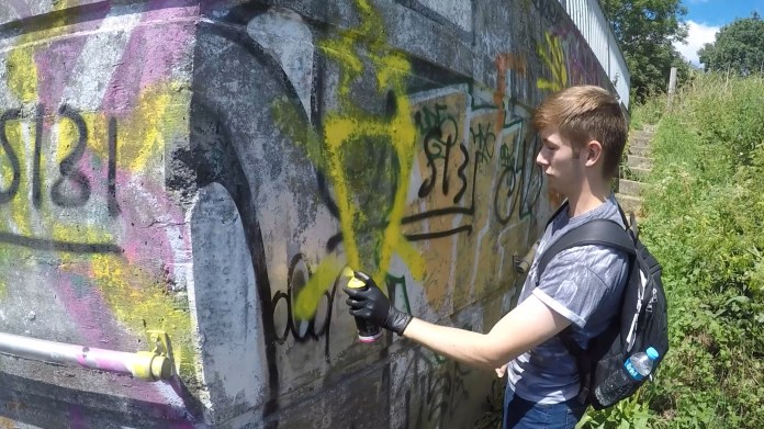 He was filmed spray-painting NA graffiti on a all