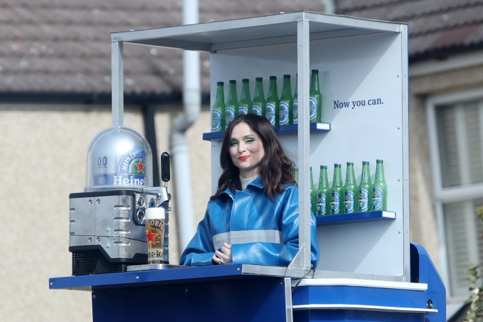 Sophie Ellis-Bextor filming an ad for Heineken on a cherry picker