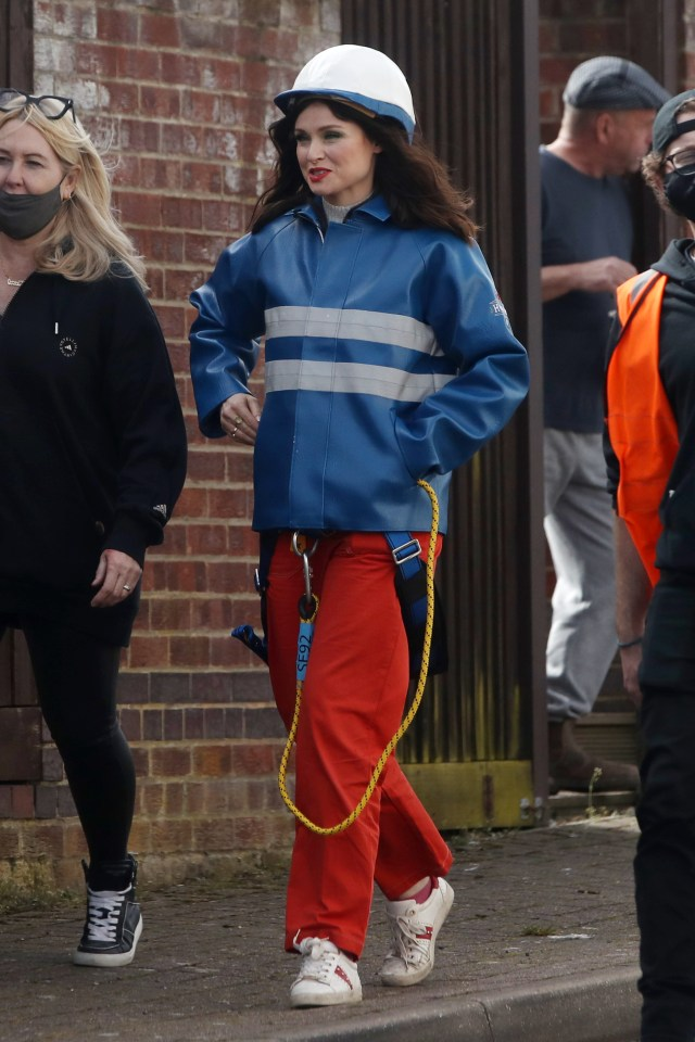 The singer was seen in safety gear in East London