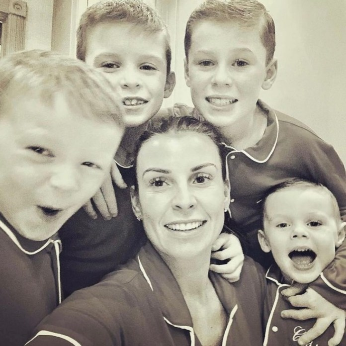 Coleen posed happily with her four sons in one snap
