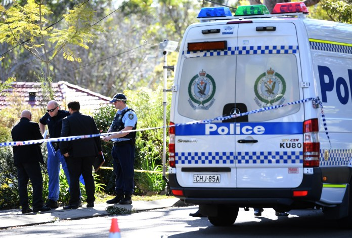 NSW Police walk towards a property on Harris Road in Normanhurst in Sydney, where the two teenagers were killed