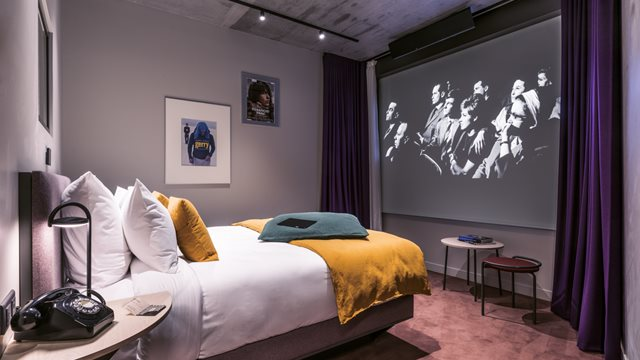 You can stay at a film-inspired hotel - with 9ft projection screens in every room