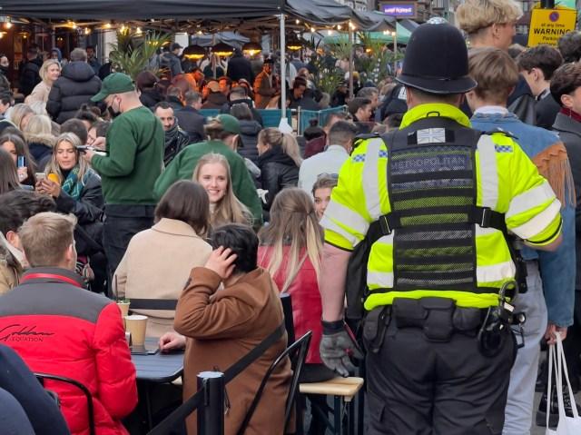 Police kept an eye on revellers in Soho, London
