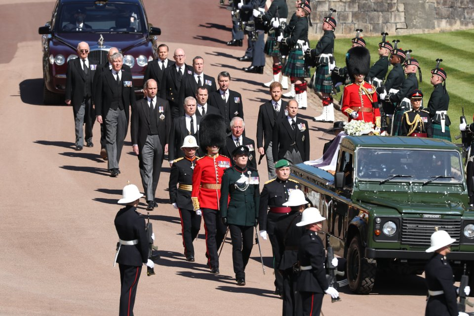 The procession behind Prince Philip's coffin in the Land Rover