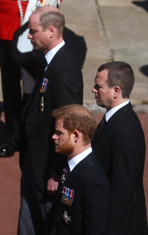 Peter Phillips stood slightly back so Harry and William were ahead of him on either side