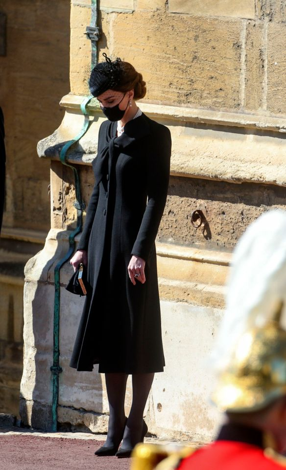The Duchess of Cambridge bows her head