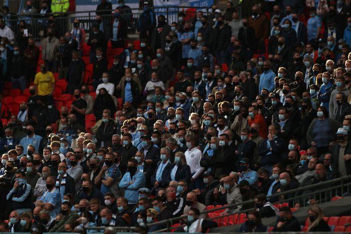 Football fans wearing masks at Wembley Stadium