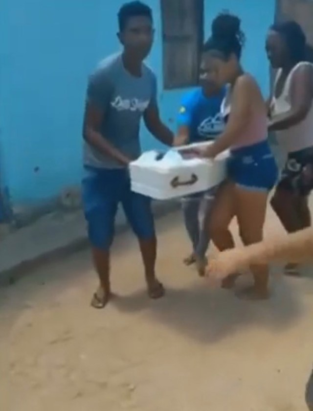 Footage shows the moment parents ran off with their baby daughter's coffin in Brazil