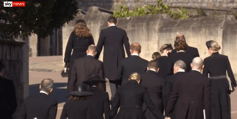 The brothers were pictured walking together and talking after the service