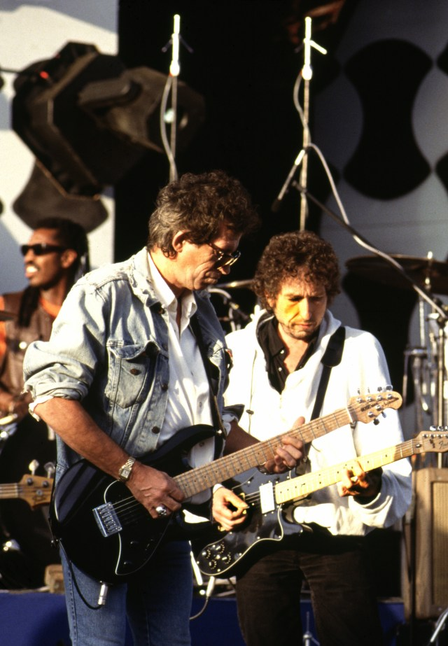 Keith Richards (pictured 1991) and Mick Jagger became friends with Dylan and sang together at Philadelphia's Live Aid show