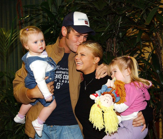 Carey posed with ex-husband Brian McFadden and their two daughters Lily-Sue and Molly