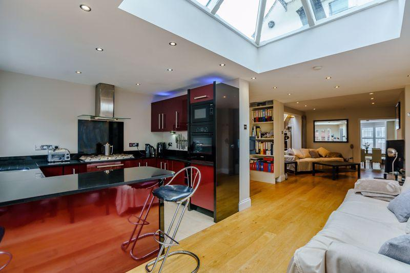 A glass roof allows the kitchen and living area to be bathed in sunlight