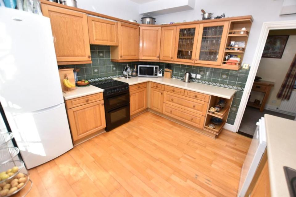 The kitchen is spacious and modern