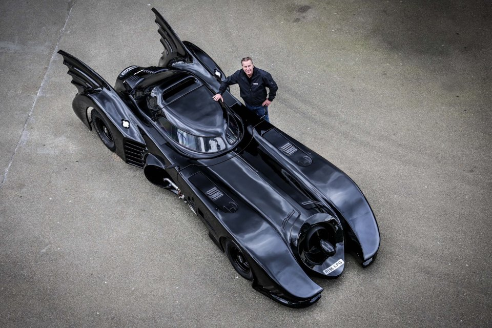 Car-batty Mark Perkins poses alongside one of his many iconic motors, the Batmobile
