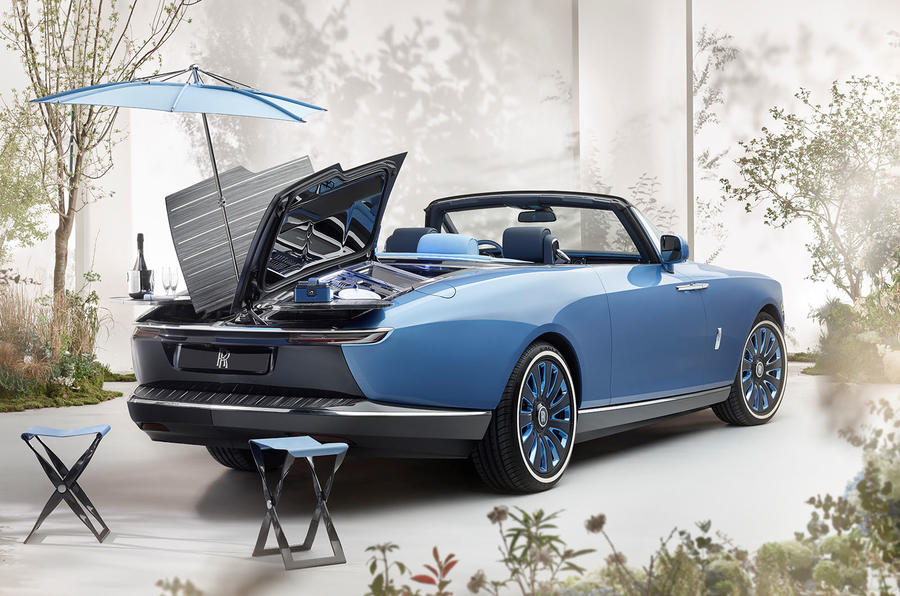 The car comes complete with picnic table and parasol in the boot