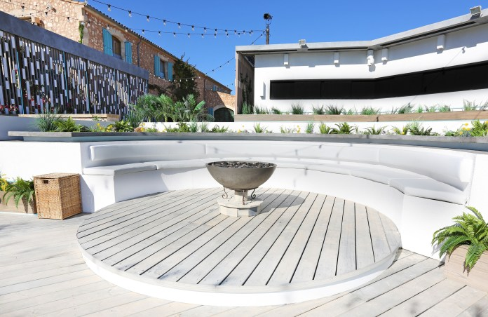 The villa's fire pit, where most of the play begins, stands