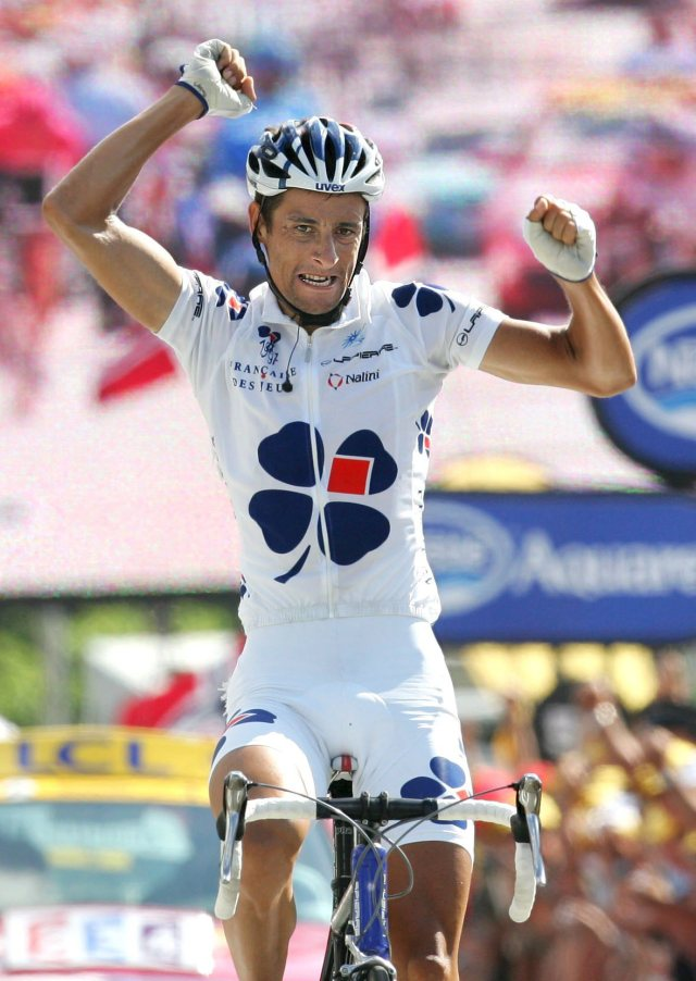 Sandy Casar road to victory after a dog sent him flying off his bike