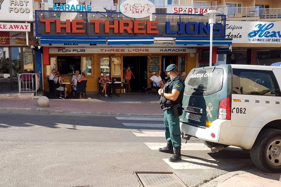 Police outside a bar before the shutdown