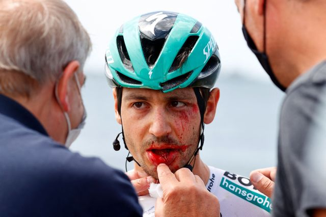 Germany's Emanuel Buchmann is examined after being involved in a massive pack crash during the 15th stage of the Giro