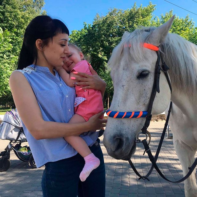 Ruzankina reportedly held the girl by her t-shirt