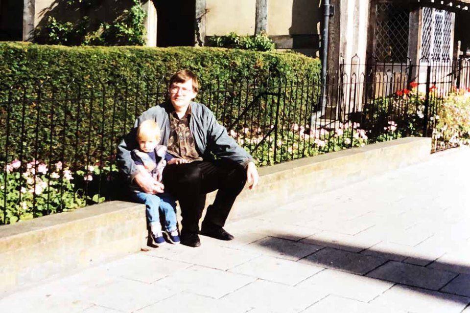 Adam as a toddler with his dad David