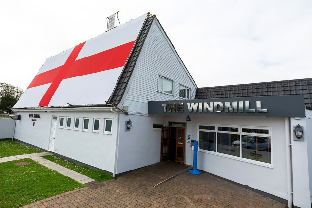 The massive flag covers one side of the pub's roof