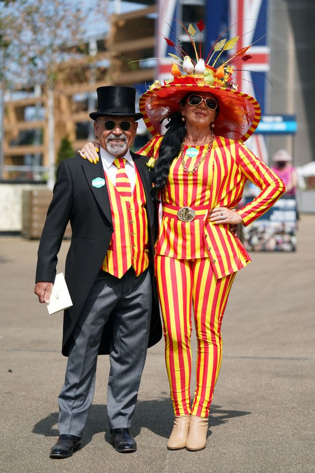 This couple went bold for their matching yellow and red striped outfits