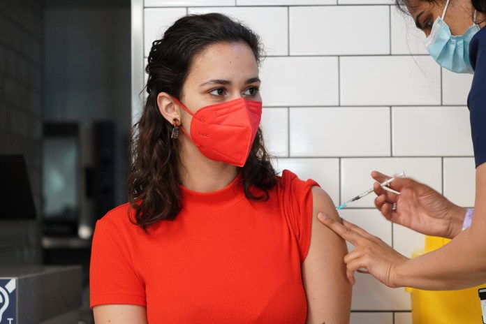 Brits could have a double jab of a flu vaccine and Covid booster shot