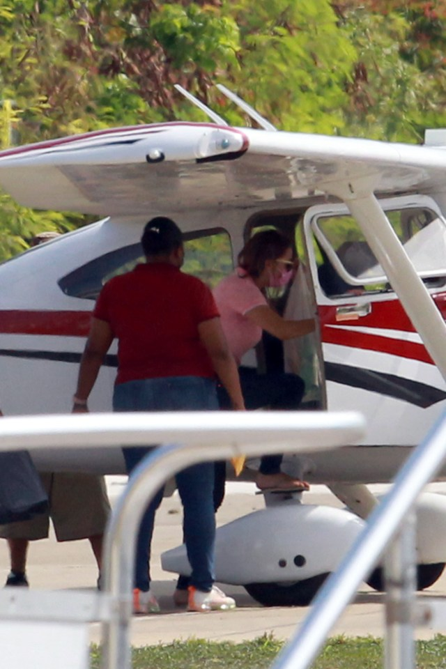She was pictured boarding a plane to go back to jail