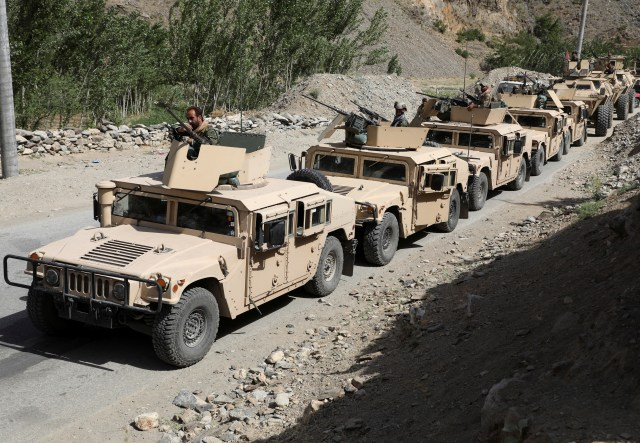 Afghan forces in an armoured convoy as they prepare to defend against the Taliban