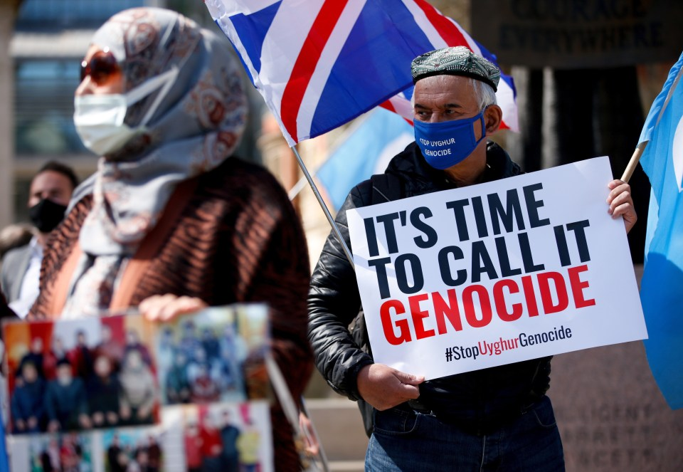 Members of the Uighur community and human rights activists demonstrate outside the Houses of Parliament in London