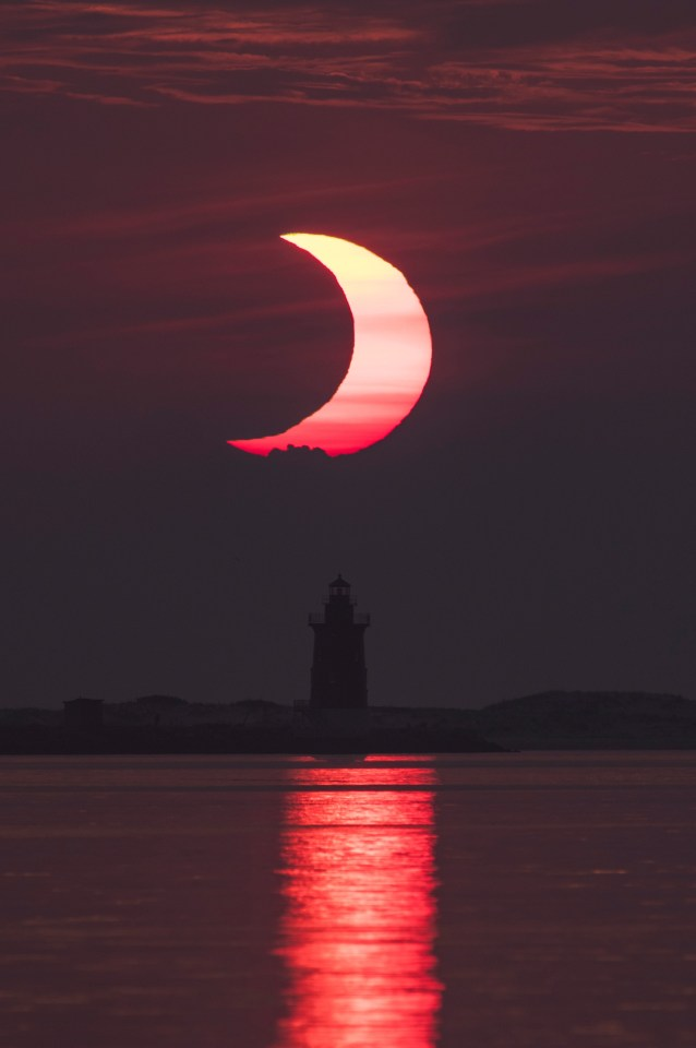 Partial eclipse over Delaware Breakwater Lighthouse in the US