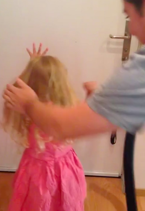 A dad vacuumed his daughter's hair into a neat ponytail