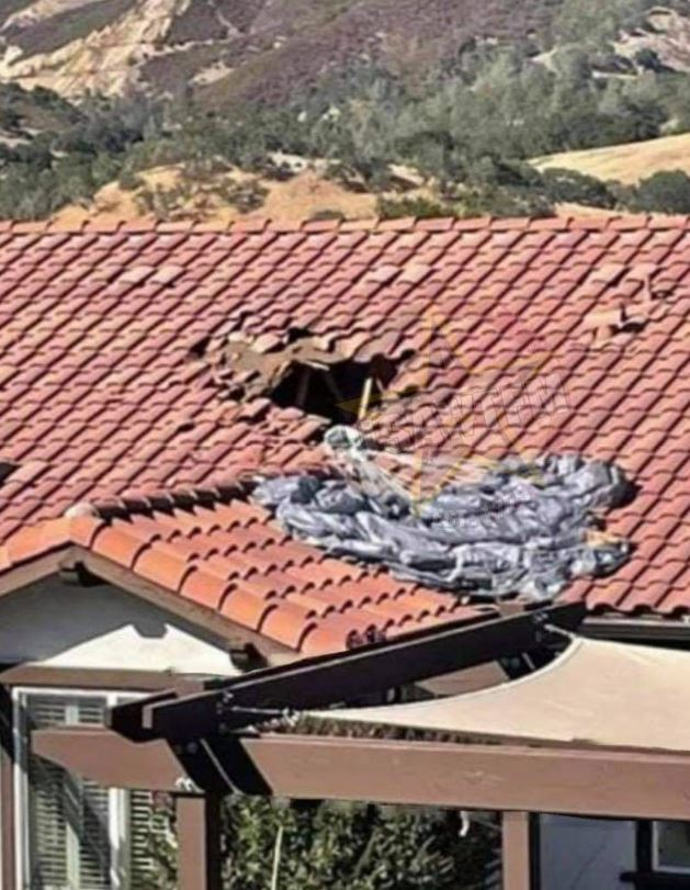 The hole in the roof made by his entry