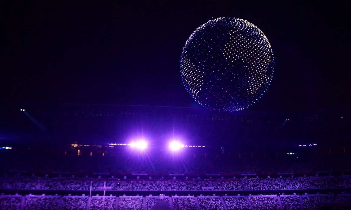 Thousands of drones form incredible globe flying over Tokyo's stadium as  Olympic Games begin with epic opening ceremony