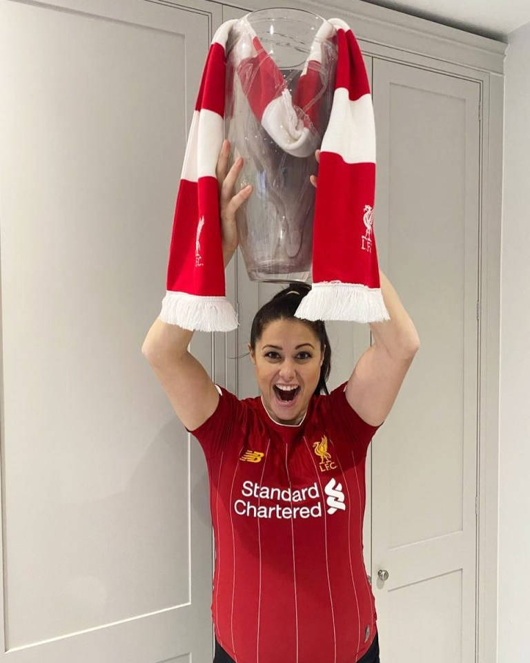 Liverpool fan Quek shows her support for the Reds