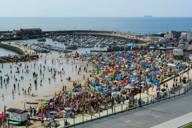 Brits packed a beach in Dorset enjoying the last of the scorching weather