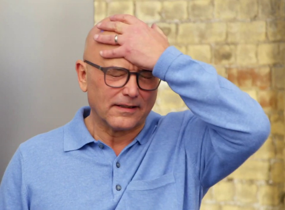 Judge Gregg Wallace is seen with his head clasped to his head in frustration