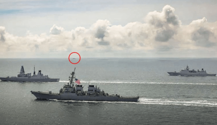 HMS Defender and HNLMS Evertsen and USS Laboon in operations in the Black Seain June - with a Russian vessel visible on the horizon