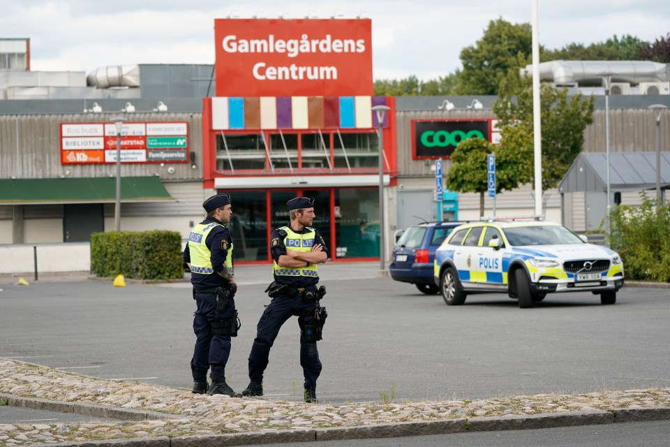 Police officers at the scene of the shootings