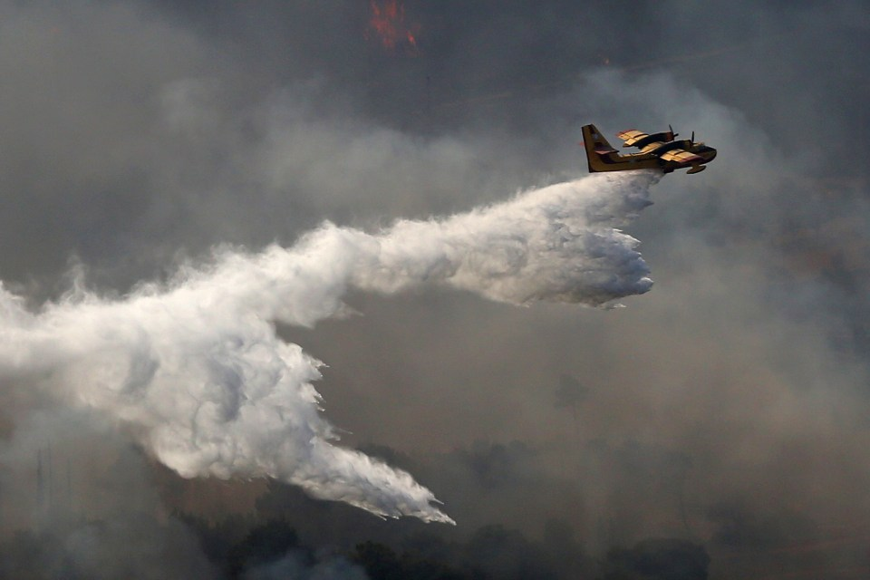 Planes have also been drafted in to water the fires from the scorched skies above