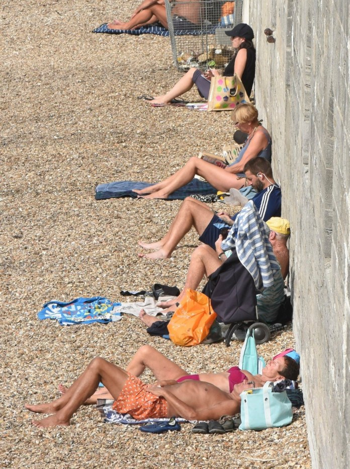 People catch some rays while going out in Portsmouth