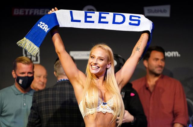 The Aussie held up a Leeds scarf at the weigh-in