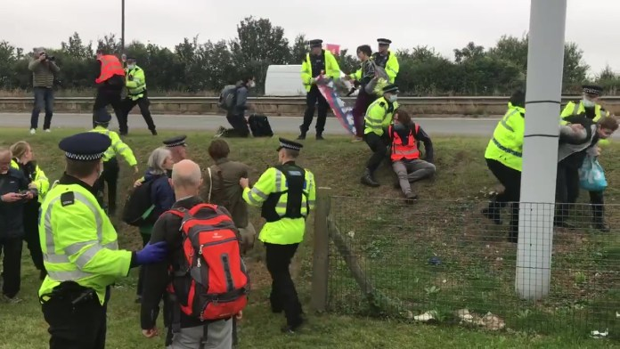 Police in Kent foil an attempt by climate change activists to block the M25 in Dartford