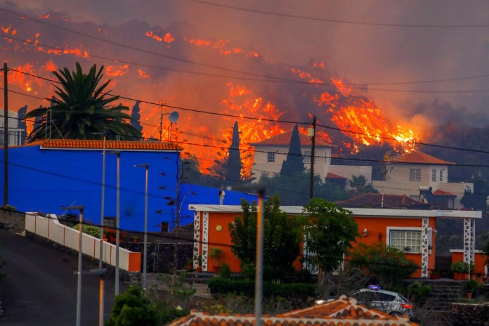 Lava flows behind houses after huge explosion