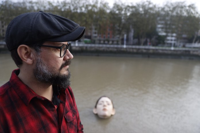 Mexican artist Rubén Orozco next to his sculpture 'Bihar' in Bilbao, Basque Country, northern Spain
