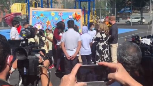 Meghan was seen hugging kids at a mural painted by the pupils