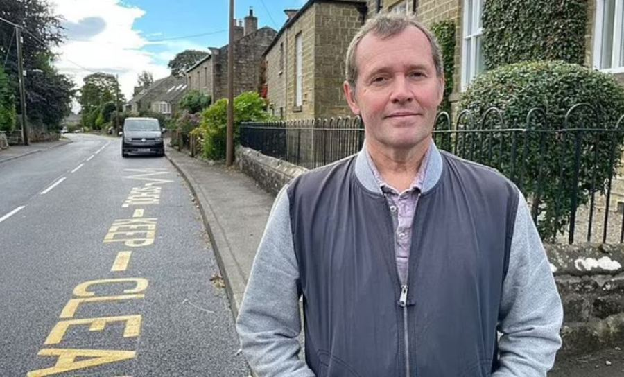 Greg Smith was stunned after councilors painted yellow zigzag lines outside his home - a converted school