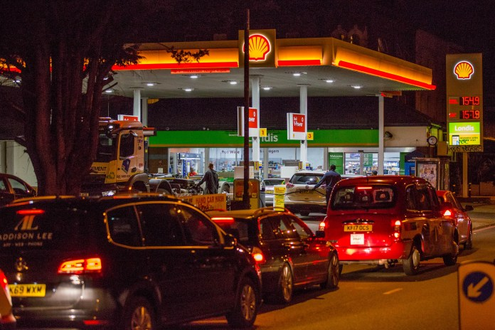Motorists wait to refuel at a petrol station in Peckham, south London